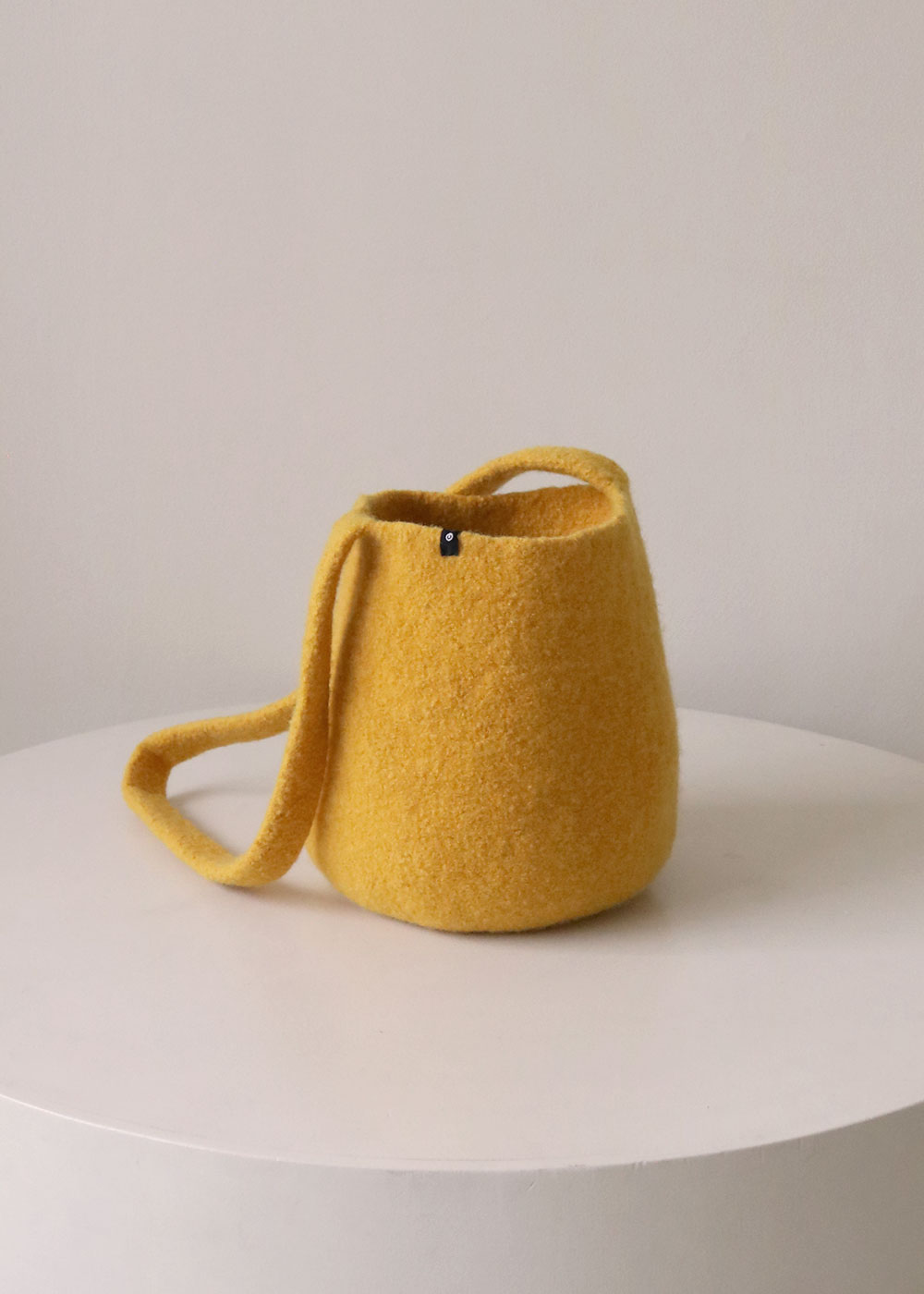 LONG STRAP BUCKET BAG